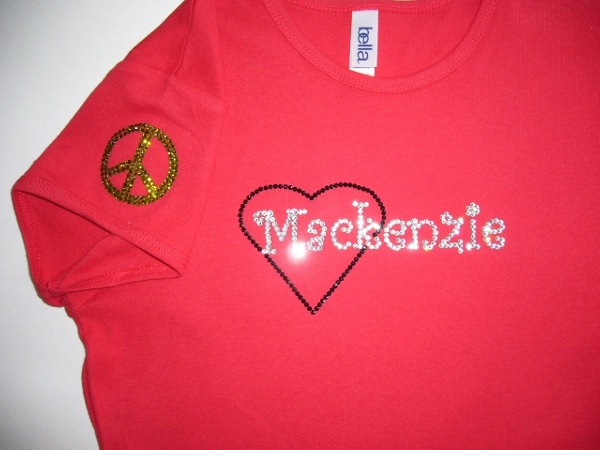 Mackenzie with heart & peace sign